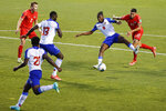 Haiti's Leverton Pierre (8) defends against Canada's Jonathan Osorio (21) during the first half of a World Cup qualifying soccer match Tuesday, June 15, 2021, in Bridgeview, Ill. (AP Photo/Kamil Krzaczynski)