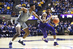 TCU guard Jaire Grayer (5) is defended by West Virginia forward Derek Culver during the first half of an NCAA college basketball game Tuesday, Jan. 14, 2020, in Morgantown, W.Va. (AP Photo/Kathleen Batten)