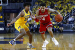 Ohio State guard Duane Washington Jr. (4) drives on Michigan guard Eli Brooks (55) in the first half of an NCAA college basketball game in Ann Arbor, Mich., Tuesday, Feb. 4, 2020. (AP Photo/Paul Sancya)