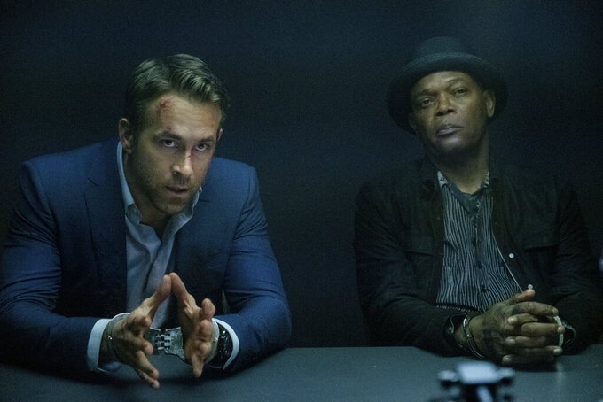 """This image released by Lionsgate shows Ryan Reynolds, left, and Samuel L. Jackson in a scene from """"The Hitman's Wife's Bodyguard."""" (David Appleby/Lionsgate via AP)"""