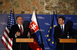 Slovakia Foreign Affairs Minister Miroslav Lajcak, right, and US Secretary of State Mike Pompeo address the media during a press conference in Bratislava, Slovakia, Tuesday, Feb. 12, 2019. Pompeo is in Slovakia on the second leg of a five-nation European tour that began in Hungary and will take him to Poland, Belgium and Iceland.  (AP Photo/Petr David Josek)