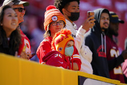 Kansas City Chiefs fans watch players take the field during pregame warmups prior to the start of the first half of an NFL football game against the Washington Football Team, Sunday, Oct. 17, 2021, in Landover, Md. (AP Photo/Mark Tenally)