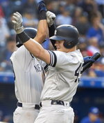 New York Yankees designated hitter Luke Voit (45) celebrates his home run against the Toronto Blue Jays with Gio Urshela during the sixth inning the sixth inning of a baseball game in Toronto, Saturday, Sept. 14, 2019. (Fred Thornhill/The Canadian Press via AP)