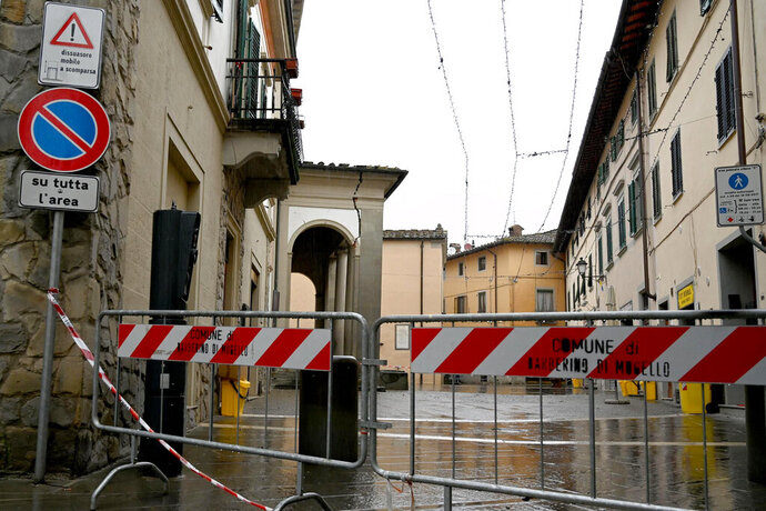 An area is sealed off as a crack is seen along the portico of San Silvestro church in Barberino del Mugello, north of Florence, Italy, Monday, Dec. 9, 2019, after an earthquake struck Tuscany early Monday. Mayors of towns in the area near the Appennine mountains known as Mugello said there were no injuries from the pre-dawn quake. (Claudio Giovannini/ANSA via AP)