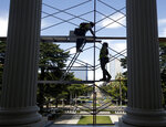 FILE - In this July 25, 2019, file photo workers assemble scaffolding on the west side of the state Capitol in preparation for a routine maintenance project, in Sacramento, Calif.  Yields on 2-year and 10-year Treasury notes inverted early Wednesday, Aug. 14, a market phenomenon that shows investors want more in return for short-term government bonds than they do for long-term bonds. It's the first time that has happened since the Great Recession and it can be a sign that investors have lost faith in the soundness of the U.S. economy. (AP Photo/Rich Pedroncelli, File)