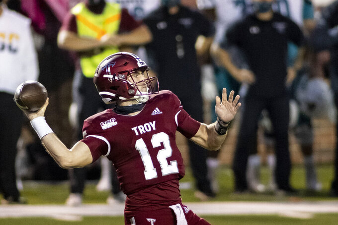 Troy quarterback Jacob Free (12) throws against Coastal Carolina during the second half of an NCAA college football game, Saturday, Dec. 12, 2020, in Troy, Ala. (AP Photo/Vasha Hunt)