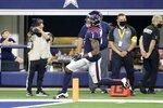 Houston Texans cornerback Lonnie Johnson Jr. (1) scores a touchdown after intercepting a pass thrown by Dallas Cowboys quarterback Ben DiNucci in the second half of a preseason NFL football game in Arlington, Texas, Saturday, Aug. 21, 2021. (AP Photo/Michael Ainsworth)
