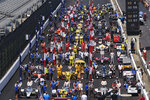 The start grid stands for the national anthem before the Indianapolis 500 IndyCar auto race at the Indianapolis Motor Speedway, Sunday, Aug. 23, 2020, in Indianapolis. (AP Photo/AJ Mast)