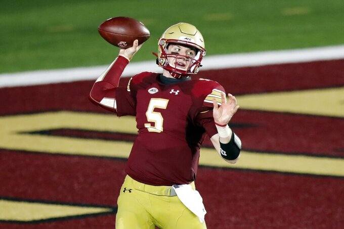 FILE - In this Sept. 26, 2020, file photo, Boston College quarterback Phil Jurkovec passes during an NCAA college football game against Texas State in Boston. The Eagles will return 20 starters from last season, among them Phil Jurkovec at quarterback. (AP Photo/Michael Dwyer, File)