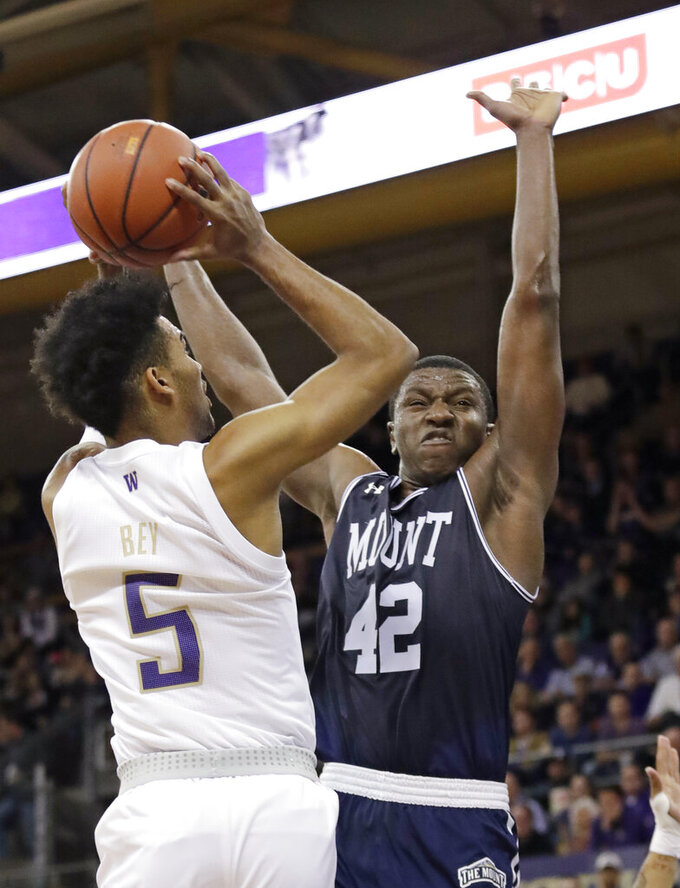 Mount St. Mary's Malik Jefferson (42) defends as Washington's Jamal Bey shoots during the first half of an NCAA college basketball game Tuesday, Nov. 12, 2019, in Seattle. (AP Photo/Elaine Thompson)