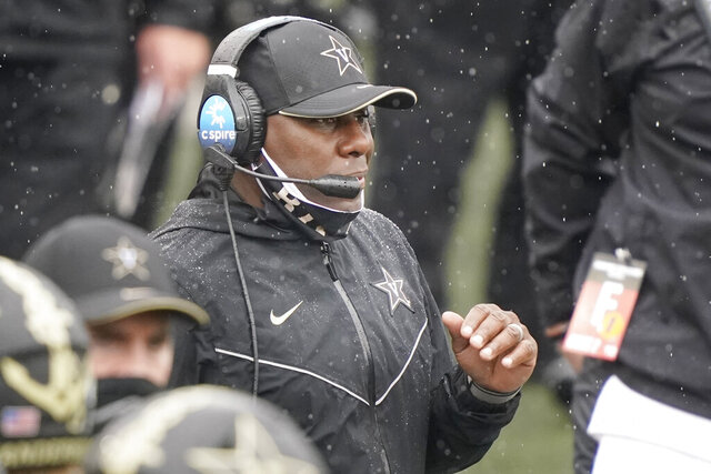 Vanderbilt head coach Derek Mason watches from the sideline in the first half of an NCAA college football game against South Carolina Saturday, Oct. 10, 2020, in Nashville, Tenn. (AP Photo/Mark Humphrey)