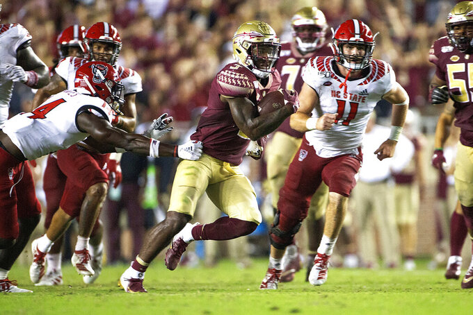 Florida State running back Cam Akers (3) runs his way to a 41-yard touchdown in the second half of an NCAA college football game against North Carolina State in Tallahassee, Fla., Saturday, Sept. 28, 2019. Florida State defeated North Carolina State 31-13. (AP Photo/Mark Wallheiser)