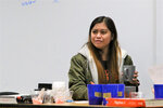 In this Oct. 17, 2019, photo, Filipino contract teacher Riva Alipin, is an integrated algebra teacher at Aztec High School in Aztec, N.M., is shown working with students. The northwestern New Mexico school district near the Navajo Nation is looking to contracted teachers from the Philippines amid a teacher shortage. (Sam Ribakoff/The Daily Times via AP)