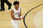 Arizona State's Remy Martin (1) celebrates after a play against Washington State during the second half of an NCAA college basketball game in the first round of the Pac-12 men's tournament Wednesday, March 10, 2021, in Las Vegas. (AP Photo/John Locher)