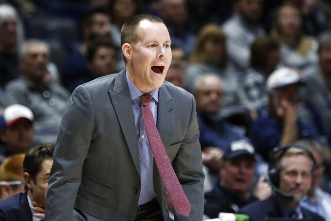 Xavier coach Travis Steele shouts during the first half of the team's NCAA college basketball game against Creighton, Wednesday, Feb. 13, 2019, in Cincinnati. (AP Photo/John Minchillo)