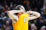Tennessee's John Fulkerson reacts after losing their NCAA college basketball game against against Cincinnati, Wednesday, Dec. 18, 2019, in Cincinnati. (AP Photo/John Minchillo)