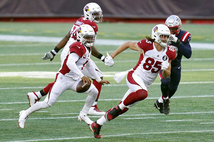 Arizona Cardinals quarterback Kyler Murray, left, runs with the ball behind tight end Dan Arnold (85) in the second half of an NFL football game against the New England Patriots, Sunday, Nov. 29, 2020, in Foxborough, Mass. (AP Photo/Charles Krupa)