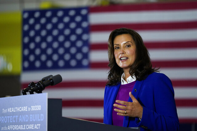 File-This Oct. 16, 2020, file photo shows Michigan Gov. Gretchen Whitmer speaking during an event with Democratic presidential candidate former Vice President Joe Biden at Beech Woods Recreation Center, in Southfield, Mich. Whitmer's administration on Sunday, Nov. 15, 2020, ordered high schools and colleges to stop in-person classes, closed restaurants to indoor dining and suspended organized sports — including the football playoffs — in a bid to curb the state's spiking coronavirus cases. The restrictions will begin Wednesday and last three weeks. (AP Photo/Carolyn Kaster, File)