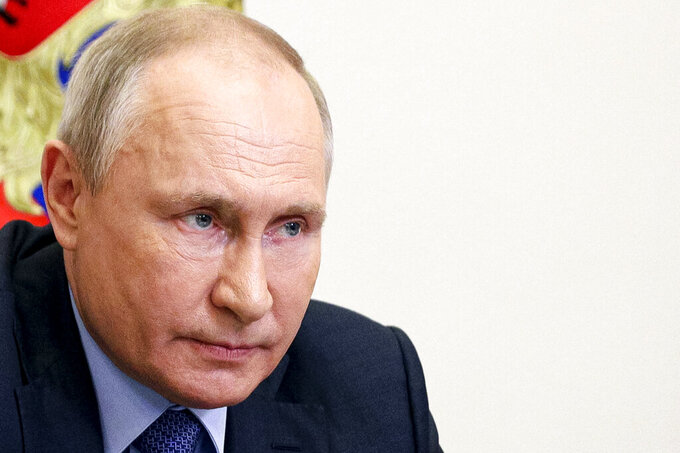 In this May 20, 2021 photo, Russian President Vladimir Putin chairs a meeting of Pobeda (Victory) organising committee via teleconference at the Novo-Ogaryovo residence outside Moscow, Russia. President Joe Biden will hold a summit with Vladimir Putin next month in Geneva, a face-to-face meeting between the two leaders that comes amid escalating tensions between the U.S. and Russia in the first months of the Biden administration. (Sergei Ilyin, Sputnik, Kremlin Pool Photo via AP)