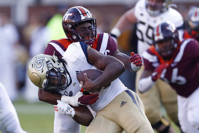 Georgia Tech running back Jordan Mason (27) is tackled by Virginia Tech defensive back Divine Deablo (17) in the first half of an NCAA football game Saturday, Nov. 16, 2019, in Atlanta. (AP Photo/John Bazemore)