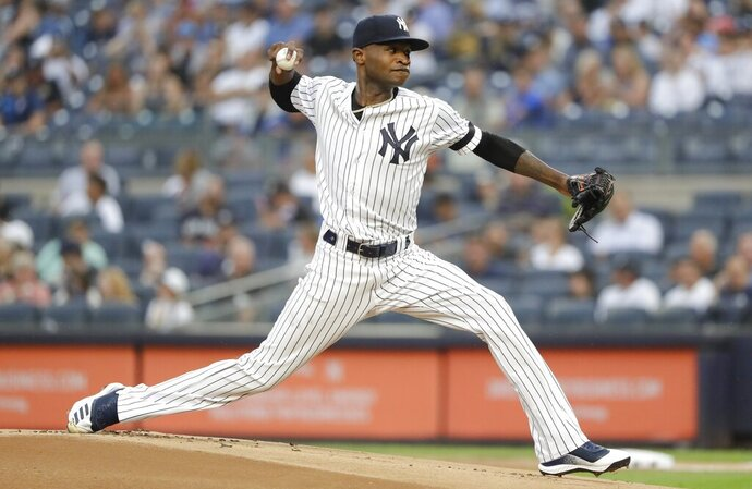 New York Yankees' Domingo German delivers a pitch during the first inning of the team's baseball game against the Baltimore Orioles on Tuesday, Aug. 13, 2019, in New York. (AP Photo/Frank Franklin II)