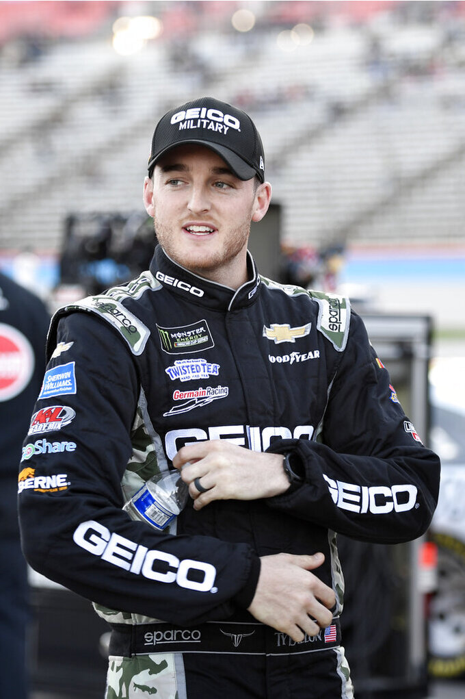 Ty Dillon stands on pit road during qualifying for a NASCAR Cup Series auto race at Texas Motor Speedway in Fort Worth, Texas, Saturday, Nov. 2, 2019. (AP Photo/Larry Papke)