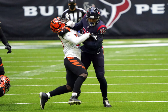 Houston Texans tight end Pharaoh Brown (85) is tackled by Cincinnati Bengals' Germaine Pratt (57) after catching a pass during the second half of an NFL football game Sunday, Dec. 27, 2020, in Houston. (AP Photo/Sam Craft)