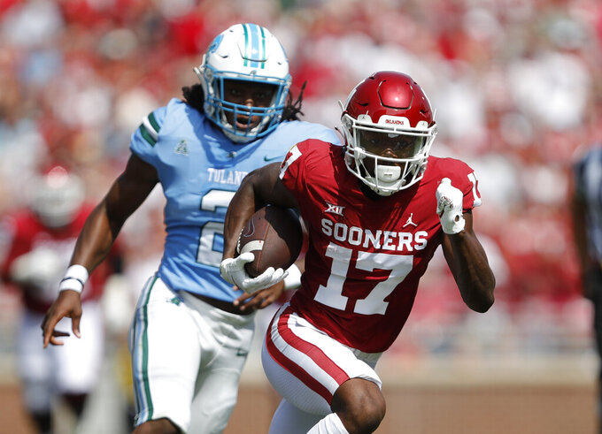 Oklahoma wide receiver Marvin Mims (17) runs ahead Tulane 's Dorian Williams (2) during a NCAA college football game Saturday, Sept. 4, 2021, in Norman, Okla. (AP Photo/Alonzo Adams)