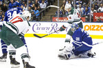 Minnesota Wild's Joel Eriksson Ek (14) and Marcus Foligno (17) watches as Luke Kunin's shot goes past Toronto Maple Leafs goaltender Frederik Andersen for the opening goal during the first period of an NHL hockey game Tuesday, Oct. 15, 2019, in Toronto. (Chris Young/The Canadian Press via AP)