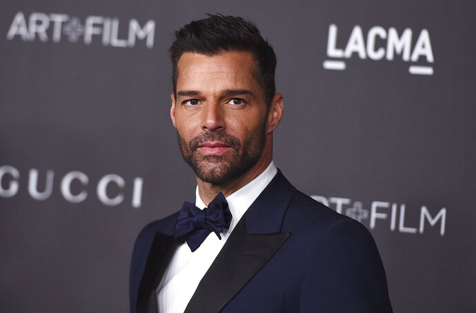 """FILE - This Nov. 2, 2019 file photo shows Ricky Martin at the 2019 LACMA Art and Film Gala in Los Angeles. Martin will perform his latest song """"Cántalo"""" with Residente and Bad Bunny at the Latin Grammy Awards on Thursday, Nov., 14, and will also serve as master of ceremonies along actresses Roselyn Sánchez and Paz Vega. (Photo by Jordan Strauss/Invision/AP, File)"""