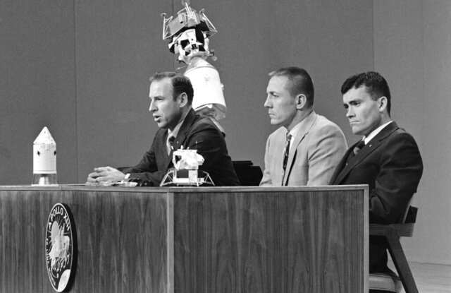 FILE - In this April 21, 1970 file photo, Apollo 13 commander James A. Lovell Jr., left, opens the astronauts televised news conference at the Manned Spacecraft Center, Houston, by saying