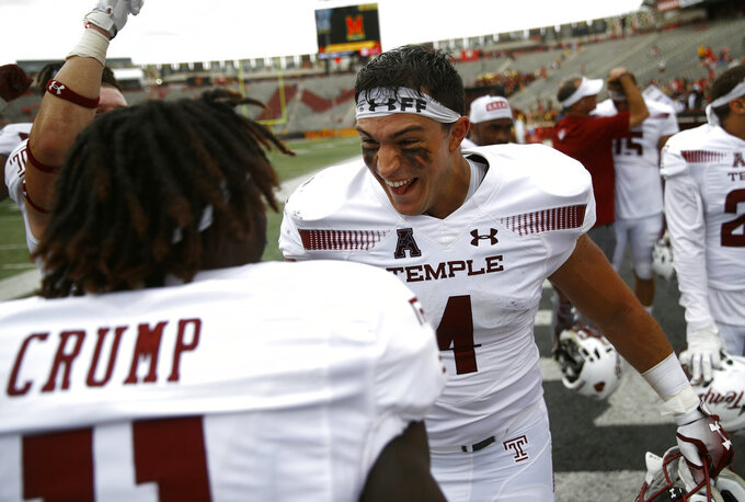 Temple fullback Rob Ritrovato, right, celebrates with teammate Linwood Crump after an NCAA college football game against Maryland, Saturday, Sept. 15, 2018, in College Park, Md. Temple won 35-14. (AP Photo/Patrick Semansky)