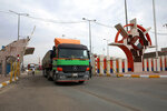 Trucks leave the port of Umm Qasr after the entrance was cleared of protesters  by security forces, Iraq, Thursday, Nov. 7, 2019. Iraqi officials say work has resumed in one of the country's largest ports after it was closed for days by Anti-government protesters. (AP Photo/Nabil al-Jourani)