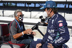 Mario Andretti, left, talks with Fernando Alonso, of Spain, before the final practice session for the Indianapolis 500 auto race at Indianapolis Motor Speedway, Friday, Aug. 21, 2020, in Indianapolis. The 104th running of the Indianapolis 500 auto race is scheduled to run on Sunday.  (AP Photo/Darron Cummings)