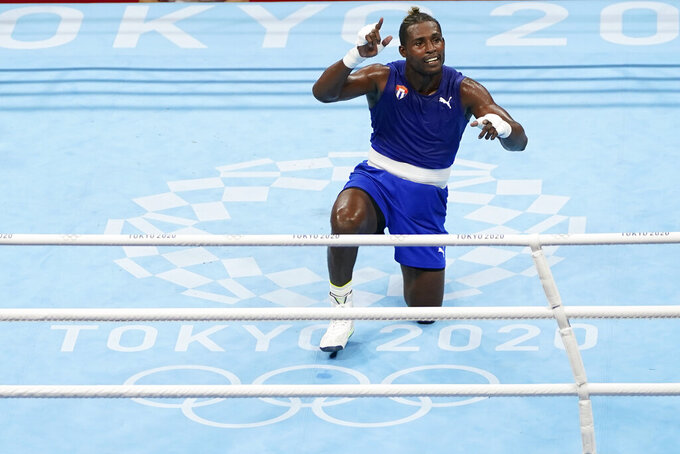 Cuba's Julio la Cruz celebrates his victory over Muslim Gadzhimagomedov, of the Russian Olympic Committee in the men's heavyweight 91-kg boxing match at the 2020 Summer Olympics, Friday, Aug. 6, 2021, in Tokyo, Japan. (AP Photo/Frank Franklin II)
