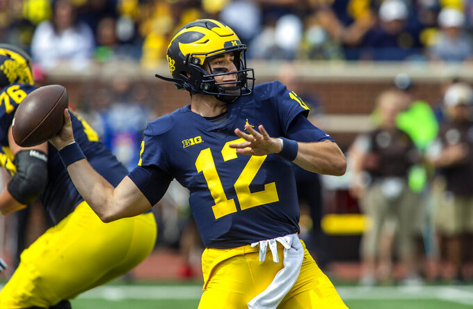 Michigan quarterback Cade McNamara (12) throws a pass in the first quarter of an NCAA college football game against Western Michigan in Ann Arbor, Mich., Saturday, Sept. 4, 2021. (AP Photo/Tony Ding)