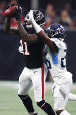 Atlanta Falcons wide receiver Julio Jones (11) makes ther catch against Tennessee Titans cornerback Logan Ryan (26) during the first half of an NFL football game, Sunday, Sept. 29, 2019, in Atlanta. (AP Photo/John Bazemore)