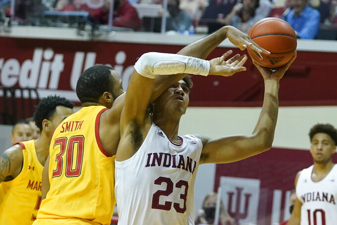 Indiana forward Trayce Jackson-Davis (23) is fouled by Maryland forward Galin Smith (30) during the second half of an NCAA college basketball game, Monday, Jan. 4, 2021, in Bloomington, Ind. (AP Photo/Darron Cummings)