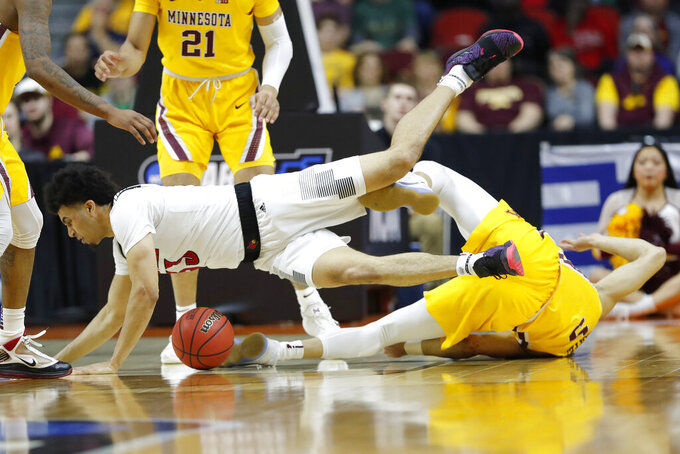 Louisville forward Jordan Nwora is fouled by Minnesota guard Amir Coffey, right, during a first round men's college basketball game in the NCAA Tournament, Thursday, March 21, 2019, in Des Moines, Iowa. (AP Photo/Charlie Neibergall)