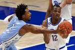 North Carolina's Leaky Black (1) tips a pass away from Pittsburgh's Abdoul Karim Coulibaly (12) during the first half of an NCAA college basketball game Tuesday, Jan. 26, 2021, in Pittsburgh. (AP Photo/Keith Srakocic)