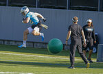 Carolina Panthers running back Christian McCaffrey jumps over a ball during an NFL football team practice in Charlotte, N.C., Tuesday, June 11, 2019. (AP Photo/Nell Redmond)