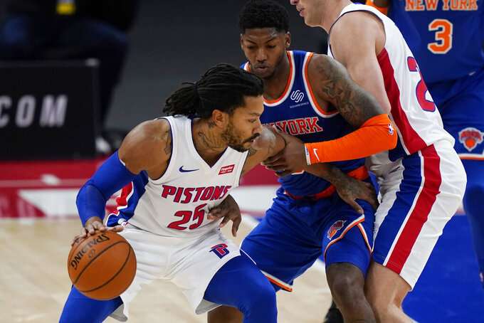 Detroit Pistons guard Derrick Rose (25) is defended by New York Knicks guard Elfrid Payton during the first half of a preseason NBA basketball game Friday, Dec. 11, 2020, in Detroit. (AP Photo/Carlos Osorio)