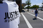 A t-shirt is clipped to a pole at an intersection near the courthouse where a court hearing was held on the release of body cam video of the shooting of Andrew Brown Jr. in Elizabeth City, N.C., Wednesday, April 28, 2021. A judge on Wednesday denied requests to release body camera video in the case of Brown, a Black man who was shot to death by North Carolina deputies as they tried to arrest him on drug-related warrants. (AP Photo/Steve Helber)