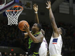 South Florida's LaQuincy Rideau, left, drives toward the basket past the arms of Connecticut's Sidney Wilson, behind center, and Eric Cobb, right, during the first half of an NCAA college basketball game, Sunday, March 3, 2019, in Storrs, Conn. (AP Photo/Steven Senne)