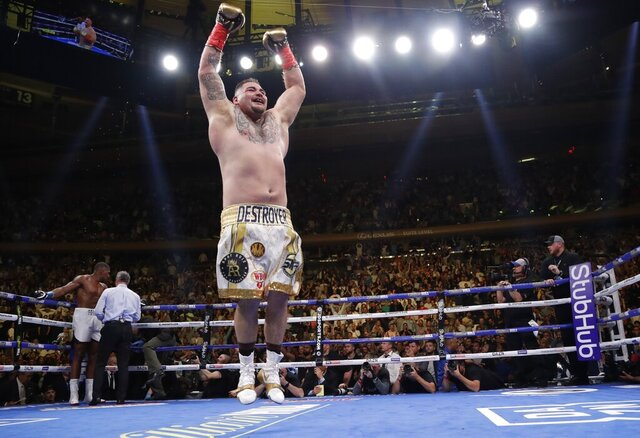 FILE - In this Saturday, June 1, 2019 file photo, Mexican American Andy Ruiz celebrates after stopping Britain's Anthony Joshua during the seventh round of a heavyweight championship boxing match in New York. Heavyweight boxing heads to new territory when Andy Ruiz Jr. and Anthony Joshua meet in a rematch in Saudi Arabia on Saturday, Dec. 7, 2019. Ruiz will look to mark the first world title fight in the Middle East for retaining the belts he took from Joshua a major shock in New York in June. (AP Photo/Frank Franklin II, File)