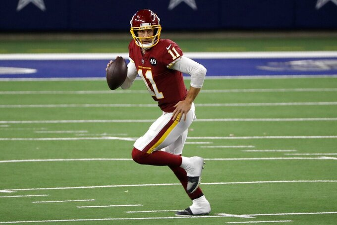 Washington Football Team quarterback Alex Smith (11) scrambles out of the pocket before throwing a pass in the second half of an NFL football game against the Dallas Cowboys in Arlington, Texas, Thursday, Nov. 26, 2020. (AP Photo/Roger Steinman)