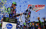 Chase Elliott, left, celebrates after winning a NASCAR Cup Series auto race at Talladega Superspeedway, Sunday, April 28, 2019, in Talladega, Ala. (AP Photo/Butch Dill)