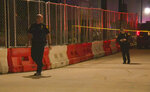 In this image made from video provided by KSAT, San Antonio police officers work near the scene of a deadly shooting at the Ventura, a music venue in San Antonio, Texas, Sunday, Jan. 19, 2020. Texas authorities says at least a few people were killed and several others were injured following the shooting during the concert inside the club. (KSAT via AP)