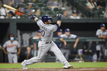 Tampa Bay Rays' Mike Zunino follows through on a three-run home run against the Baltimore Orioles in the seventh inning of baseball game, Friday, Aug. 27, 2021, in Baltimore. (AP Photo/Gail Burton)