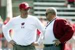 FILE - In this Sept. 15, 2018, file photo, Wisconsin head coach Paul Chryst, left, talks to athletic director Barry Alvarez before an NCAA college football game against BYU in Madison, Wis. Wisconsin announced Saturday, May 9, 2020, it is asking 25 of its highest-earning employees to volunteer for a 15% pay cut over the next six months. That group includes athletic director Barry Alvarez, football coach Paul Chryst and men's basketball coach Greg Gard. There won't be any reduction of work hours.  (AP Photo/Morry Gash, File)